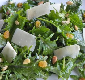 Baby Kale Salad with Raisins, Pine Nuts and Gouda